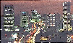 Jakarta, one of the world's 5 largest city, a skyline of part of this vast city of 12 million at night to 18 to 20 million during the day from commuters who clog up the internal and external toll roads sometimes until 10 pm.